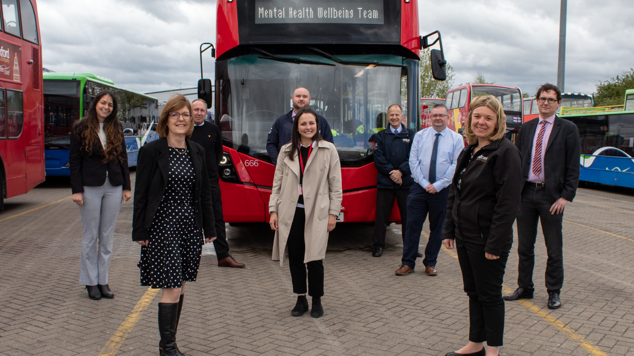 Photo of Carousel Buses wellbeing support team in front of a double decker bus